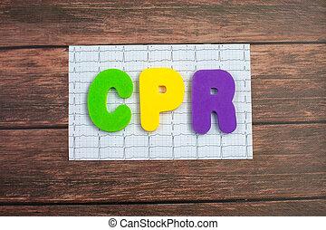 顏色, 字母表, 在, 詞, cpr, 縮寫, ......的, cardiopulmonary 复活, 躺, 上, a, 列印, cardiogram, ......的, 心, 上, 木頭, 背景。
