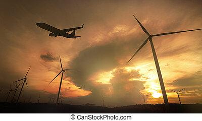 黑色半面畫像, ......的, 風車, 為, 電力, 生產, 以及, 飛機, 起飛, 上, the, 鮮艷, 戲劇性的天空, 由于, 雲, 在, 傍晚, 背景