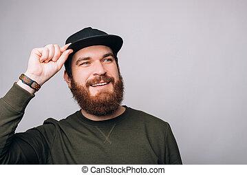 黒, あごひげを生やしている, ハンサム, 帽子, 人, 白, 身に着けていること, バックグラウンド。