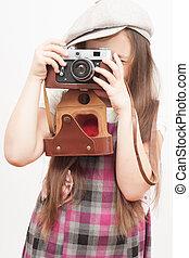 사진사, 소녀, 통하고 있는, a, 백색 배경
