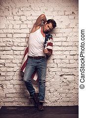 성적 매력이 있는, 남성, 모델, 자세를 취함, 와, 하얀 t셔츠, 와..., jeans, on., 복합어를 이루어 ...으로 보이는 사람, 유행