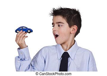 소년, 보는, 장난감 차, 에서, 그의 것, 손
