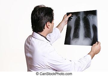 시험하는, 엑스선으로 검사하다
