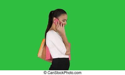 은 자루에 넣는다, 쇼핑하고 있는 여성, 말하는 것, 변하기 쉬운, chroma, 스크린, 전화, 녹색, key., 흥분한다
