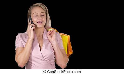 은 자루에 넣는다, 쇼핑하고 있는 여성, 변하기 쉬운, 나이 적은 편의, 말하는 것, 전화, 알파 채널