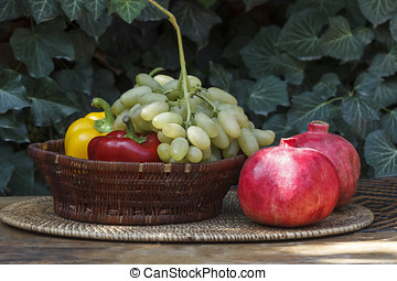 - Grapes in a wicker basket against a background of green ivy