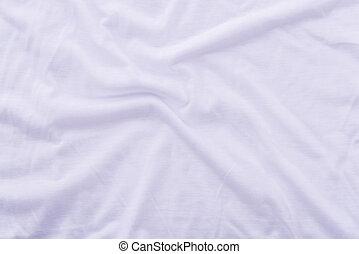 Tela de sábanas arrugadas. Cerca de una hermosa y arrugada