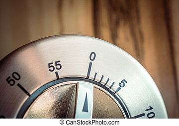 0 Minutes - 1 Hour - Macro Of An Analog Chrome Kitchen Timer In Front Of A Wooden Background