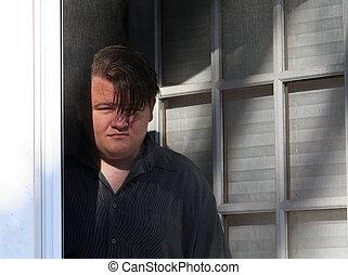 00008D - Teenage Boy standing between two doors, serious...