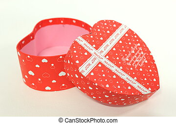 Red Heart-shaped Gift Box on White Background.