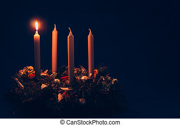 1. advent candle burning on advent wreath