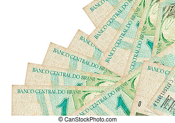 1 Brazilian real bills lies in different order isolated on white. Local banking or money making concept