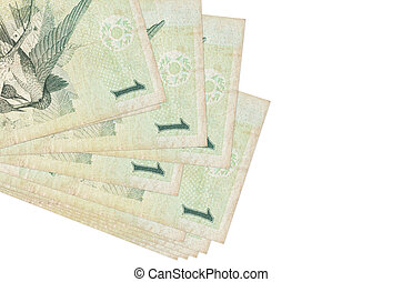 1 Brazilian real bills lies in small bunch or pack isolated on white. Mockup with copy space. Business and currency exchange