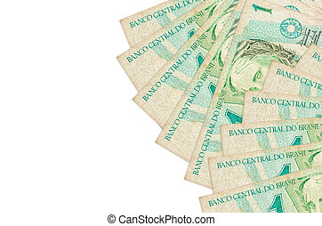 1 Brazilian real bills lies isolated on white background with copy space. Rich life conceptual background
