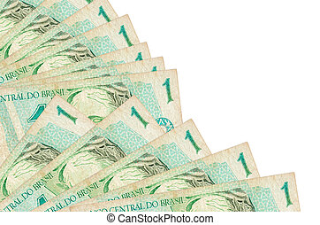 1 Brazilian real bills lies isolated on white background with copy space stacked in fan close up