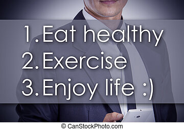 1.  Eat healthy 2. Exercise 3. Enjoy life :) - Young businessman with text - business concept