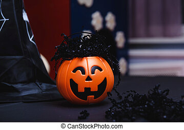 1 pumpkin on the table, black witch hat on a dark