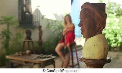 1-Sculptor Chiseling Wooden Statue Working With Model In Atelier