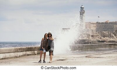 1-Tourist Girls Taking Selfie With Mobile Phone In Habana Cuba
