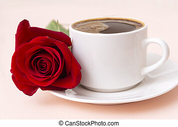 1 white Cup of black coffee on saucer, red rose flower,