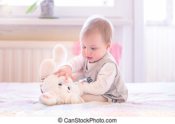 1 year old baby girl playing