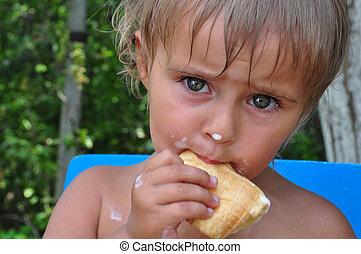 child eating melting ice-cream