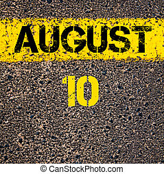 10 August calendar day over road marking yellow paint line