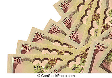 10 Nepalese rupees bills lies in different order isolated on white. Local banking or money making concept. Business background banner