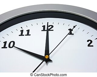 Top area of a wall clock showing 10 am pm