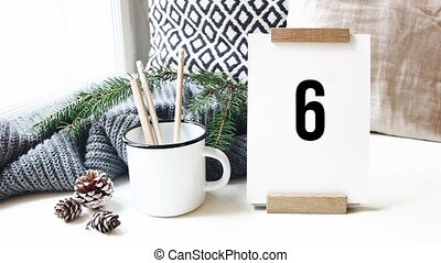 10 second countdown. Calendar, pine cones and mug with...