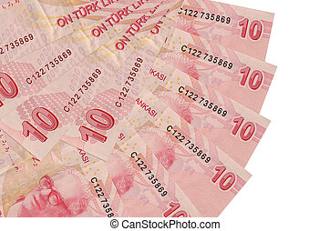 10 Turkish liras bills lies isolated on white background with copy space stacked in fan shape close up. Financial transactions concept