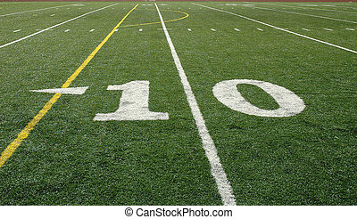 Looking across the football field from the sideline at the 10-yard line
