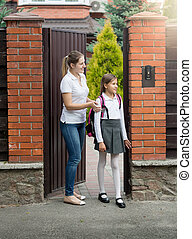 10 year old girl going to school  from house