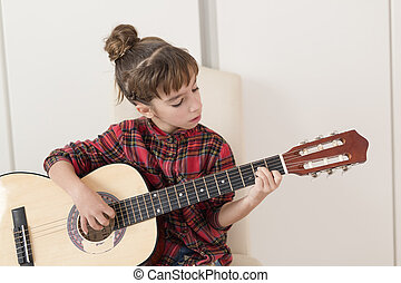10 year old girl playing the Spanish guitar.