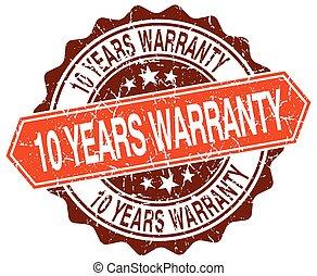 10 years warranty orange round grunge stamp on white