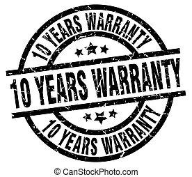 10 years warranty round grunge black stamp