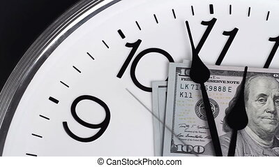$100 are on the clock. Denominations of 2009. - Money stop...