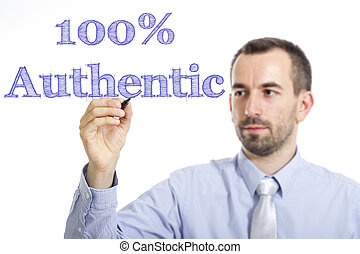 100% Authentic - Young businessman writing blue text on transparent surface