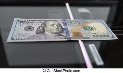$100 being copied from the scanner. Counterfeiters. Money...