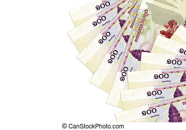 100 Cambodian riels bills lies isolated on white background with copy space. Rich life conceptual background
