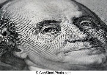 macro of an american 100 dollar bill with benjamin franklin