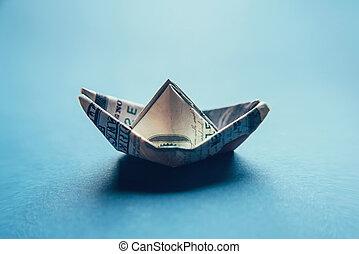 100 dollar bill in the shape of a ship.
