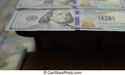 100 dollars banknote bills new paper Franklin shallow depth of field series 2009 years of production fast camera movement