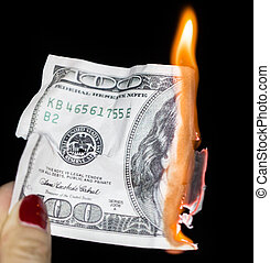 100 dollars burning on a black background