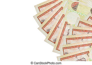 100 Dominican peso bills lies isolated on white background with copy space. Rich life conceptual background