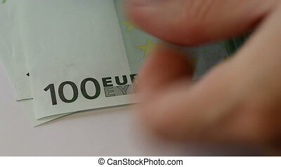 100 euro. Man counts the money