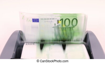100 euro notes in the counting machine - Overhead video shot...