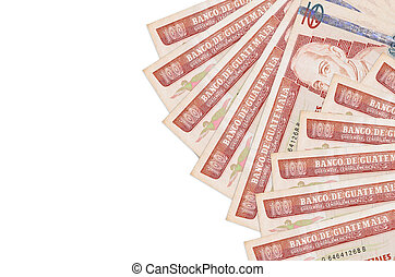100 Guatemalan quetzales bills lies isolated on white background with copy space. Rich life conceptual background
