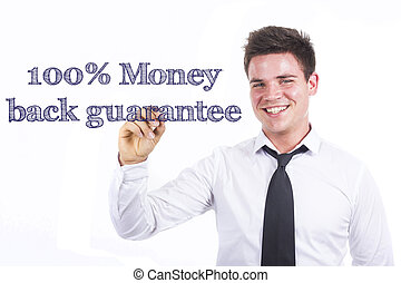100% Money back guarantee - Young smiling businessman writing on transparent surface