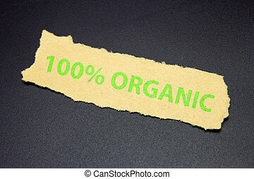100% organic text on ripped paper, eco food label
